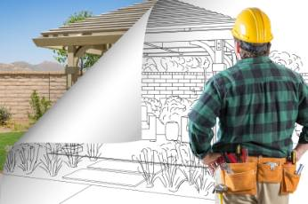 architect from Toowoomba Carports working on a project blueprint for a home renovation